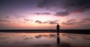 Man on beach sunrise